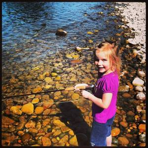 Lily struggles to reel in a nice South Fork trout.