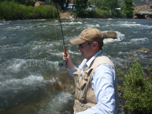 Andy battles a nice brown in the fast current