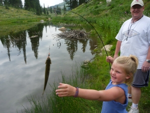 Kelly and Emmaus catch the first fish at Bloomington Lake.