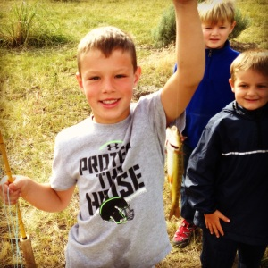 My nephew Nate shows off his first trout caught on the Old Yellow Rod.