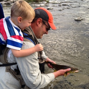 Dad and Benny admire a nice brown trout.