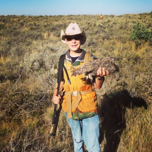 Brigham shows off his first sage grouse.  Somehow that cowboy hat just seems to work for sage grouse hunting.