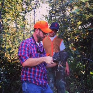 Scott checks out Brigham's blue grouse from opening day.
